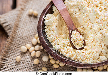 Some Soy Flour on rustic wooden background close-up shot