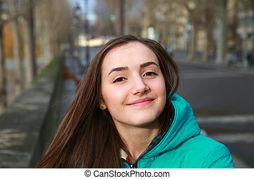 Happy beautiful girl in the city