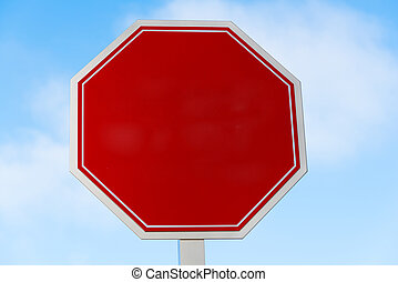 Blank red stop sign with a sky blue background