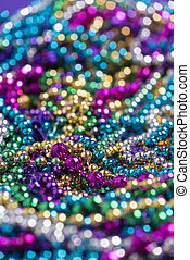 Mardi Gras beads with copy space