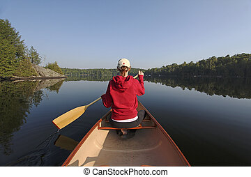 Woman Paddling a Canoe on a Northern Ontario Lake - Woman in...