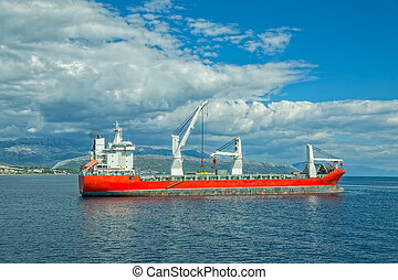 Large heavy lift ship - A large heavy lift ship anchored in...