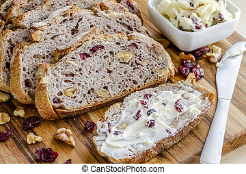 Fresh Baked Cranberry Walnut Bread - Slices of walnut...