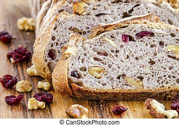 Fresh Baked Cranberry Walnut Bread - Close up of slices of...