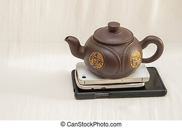 It is time for break - Chinese craft teapot on stack of...