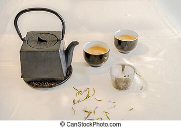 Tetsubin squire shape teapot and tea cup and tea