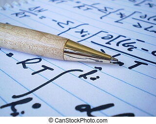 Pen and Equations - This picture shows a pen laying on a...