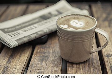coffee latte with a newspaper