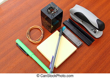 office desk and tools over a brown table background