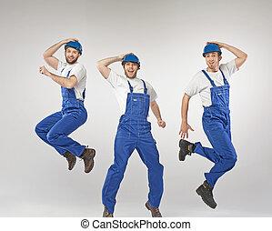 Portrait of three dancing builders