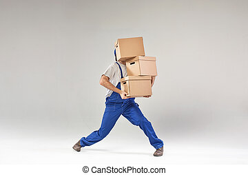 Hard-working builder holding paper boxes - Hard-working...