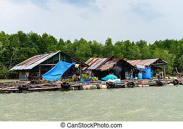 Float fishing village on tropical river