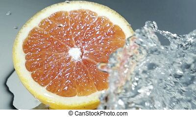 Orange fruits and Splashing water - orange in spray of...