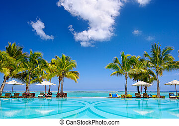 Tropical resort - Tropical beach resort with lounge chairs...
