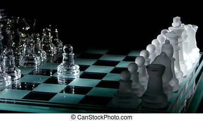 Beautiful pieces on the chessboard. black background. Pawns...