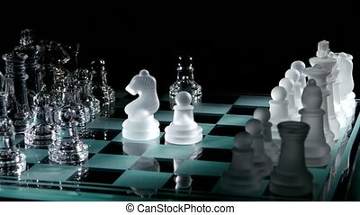 4K. Moving white chess  on glass chesboard