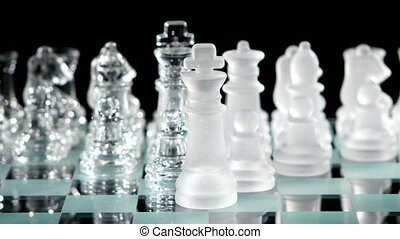 4K. Beautiful glass chess, black background. figures move on...