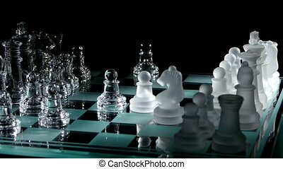 Knights move on the chessboard on black background