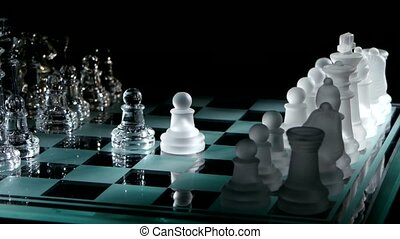 Moving pieces on the chessboard on black background