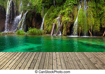 Small Waterfall - Waterfall in Plitvice lake and wooden...