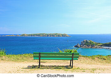 Viewpoint with green bench in Perros-Guirec, Brittany,...