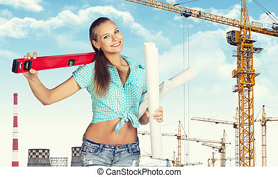 Woman holding builders level on shoulder and paper scrolls...