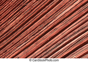 Old red wooden wall in sunlight