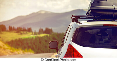car with a roof rack - car for traveling with a roof rack on...