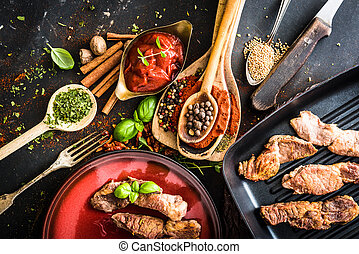 grilled meat with tomato sauce and spices - grilled meat on...