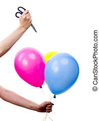 Femal Hand Bursting Colorful Balloons with Scissors