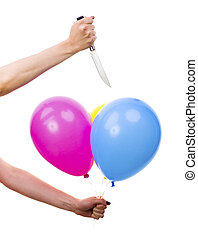 Female Hand Bursting Colorful Balloons with Knife. White...