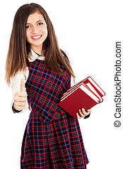 Portrait of a beautiful student girl with books showing ok...