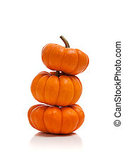 Stack of pumpkins on white