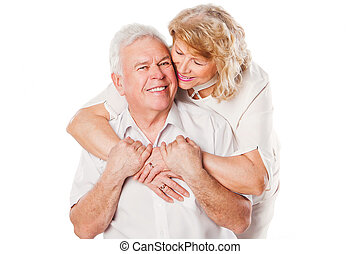 Happy smiling senior couple in love Isolated over white...