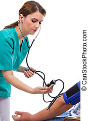 Female doctor taking blood pressure