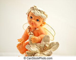 Angel boy model - A little angel boy on a artificial flower...