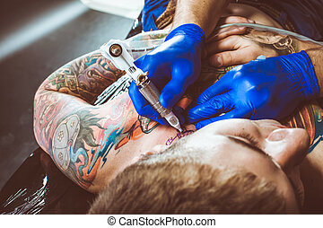 Tattooist makes a tattoo Closeup