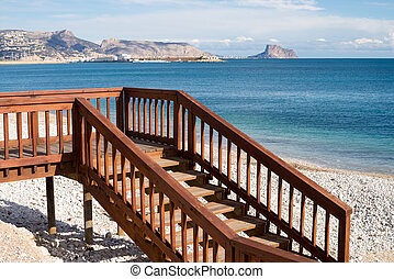 Beach access - Footbridge and steps to a sunny Mediterranean...