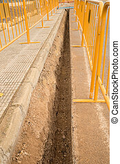 Ditch - Roadworks with a ditch for a pipeline protected by a...