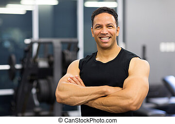 mid age male gym trainer