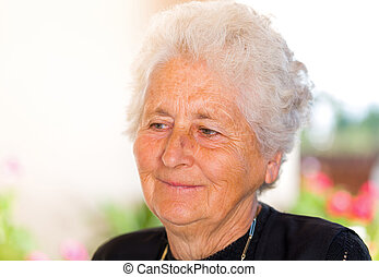 Elderly woman - Portrait of a happy retired elderly woman