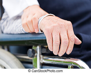 Elderly care - Hands of an elderly woman resting on the...