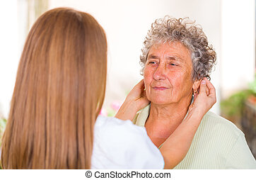 Elderly home care - Photo of elderly woman with her...