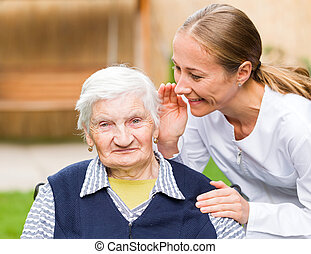 Elderly care - Photo of elderly woman with young carer