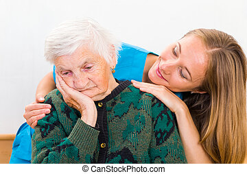 Elderly woman and young doctor - Photo of elderly woman...