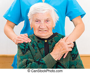 Elderly home care - Photo of elderly woman supported by...