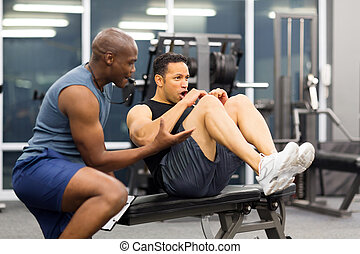 middle aged man with personal trainer - fit middle aged man...