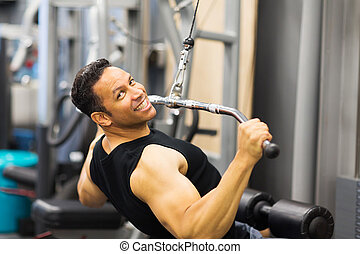 mid age man doing pull-down workout - handsome mid age man...
