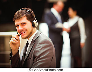 man working at callcenter - Happy young man working at...