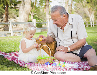 Grandfather and Granddaughter Enjoying Easter Eggs on...